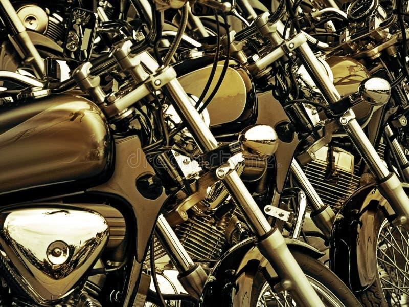 Teste padrão de motocicletas estacionadas douradas imagens de stock