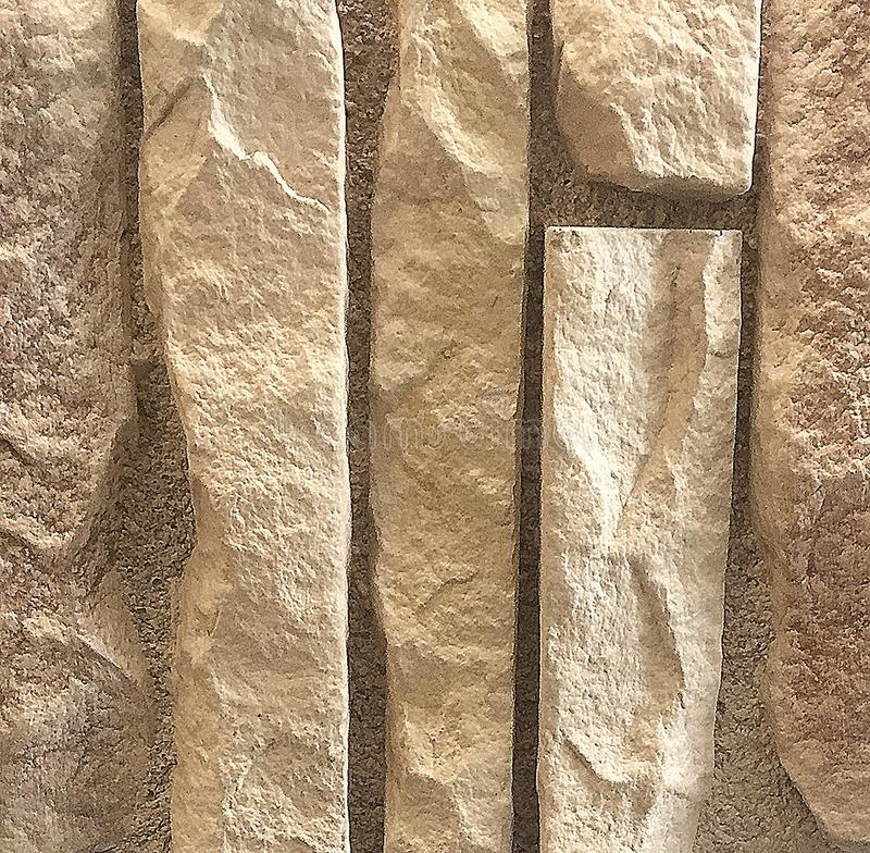 Teste padrão de pedra amarelo gravado, fundo foto de stock