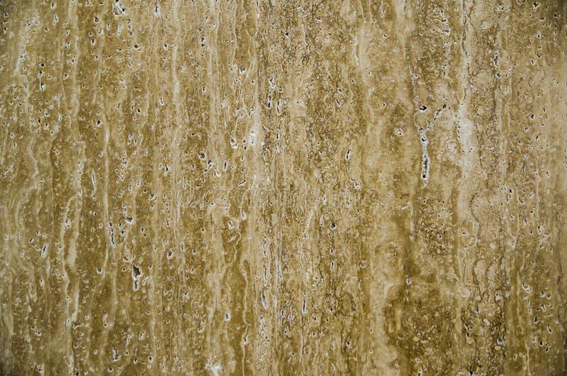 Teste padrão de pedra natural da telha do granito bege do travertino na cor marrom abstrata, fim acima fotografia de stock royalty free