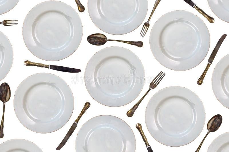 Teste padrão de placas de jantar do vintage, de facas, de forquilhas e de colheres foto de stock