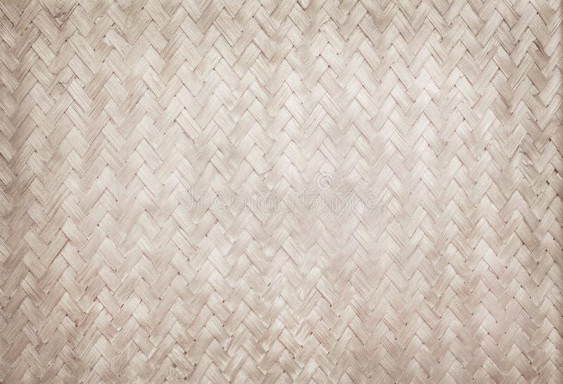 Teste padrão de tecelagem de bambu velho, textura tecida da esteira do rattan imagem de stock