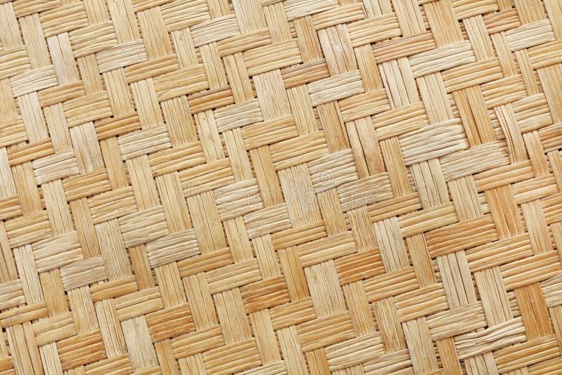 Teste padrão de tecelagem de bambu velho, textura tecida da esteira do rattan para o fundo imagem de stock royalty free