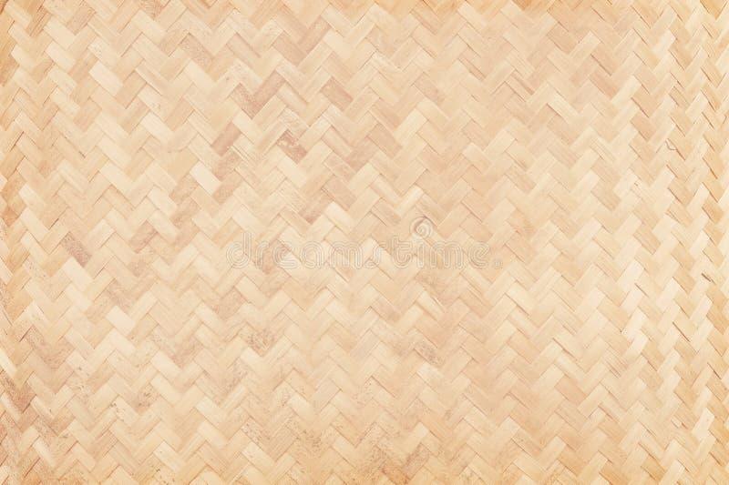 Teste padrão de tecelagem de bambu velho, textura tecida da esteira do rattan para o fundo fotografia de stock