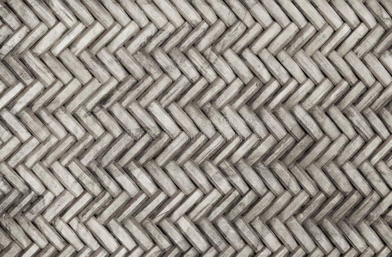 Teste padrão de tecelagem de bambu velho, textura tecida da esteira do rattan para o fundo e trabalho de arte do projeto imagem de stock