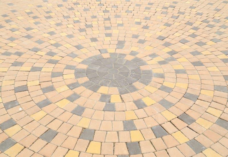 Teste padrão do círculo da pavimentação de pedra foto de stock