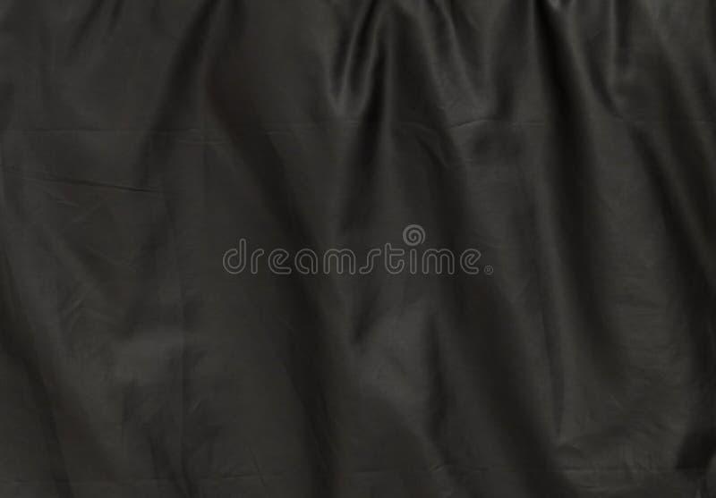 Teste padrão do fundo da textura preta amarrotada de matéria têxtil fotos de stock royalty free