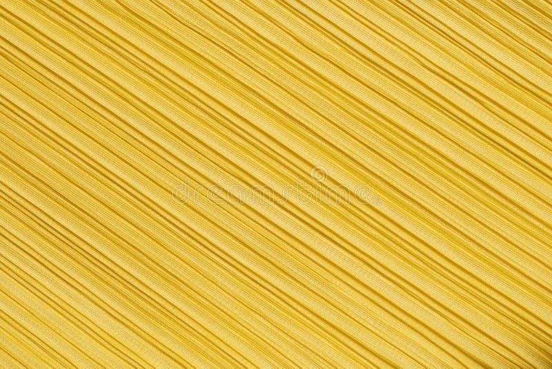 Teste padrão do sumário do close up em fundo textured da roupa de mulheres amarelas fotografia de stock royalty free