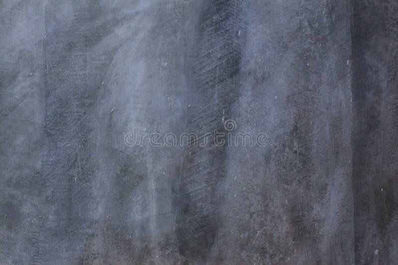 Teste padrão exposto lustrado desencapado escuro da textura do cimento no fundo da superfície da parede da casa Detalhe o context foto de stock royalty free
