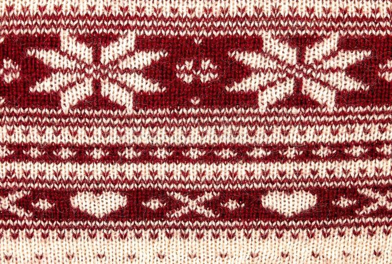 Teste padrão feito malha da caxemira das estrelas e da textura do teste padrão do inverno dos corações imagens de stock