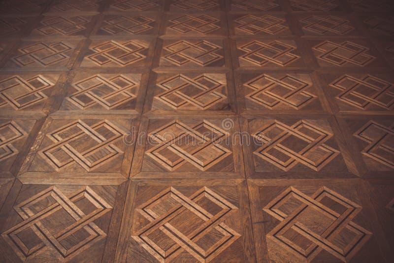 Teste padrão geométrico no assoalho de parquet marrom retângulos, quadrados, cruzes e linhas Textura, fundo imagens de stock