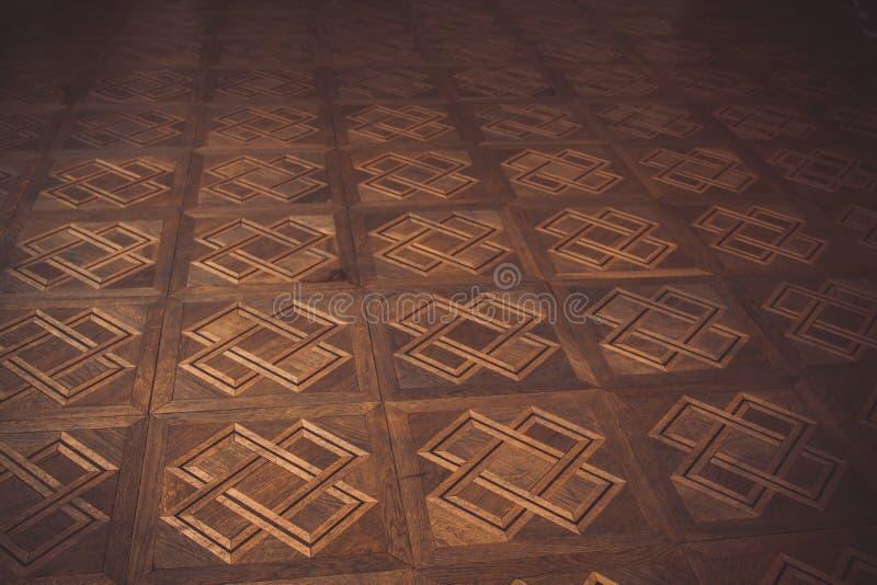 Teste padrão geométrico no assoalho de parquet marrom retângulos, quadrados, cruzes e linhas Textura, fundo imagem de stock