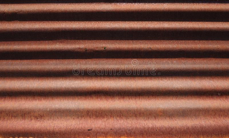Teste padrão metálico ondulado oxidado da folha foto de stock