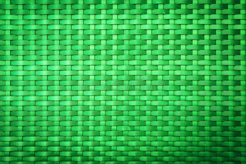 Teste padrão plástico verde do weave para o fundo imagem de stock