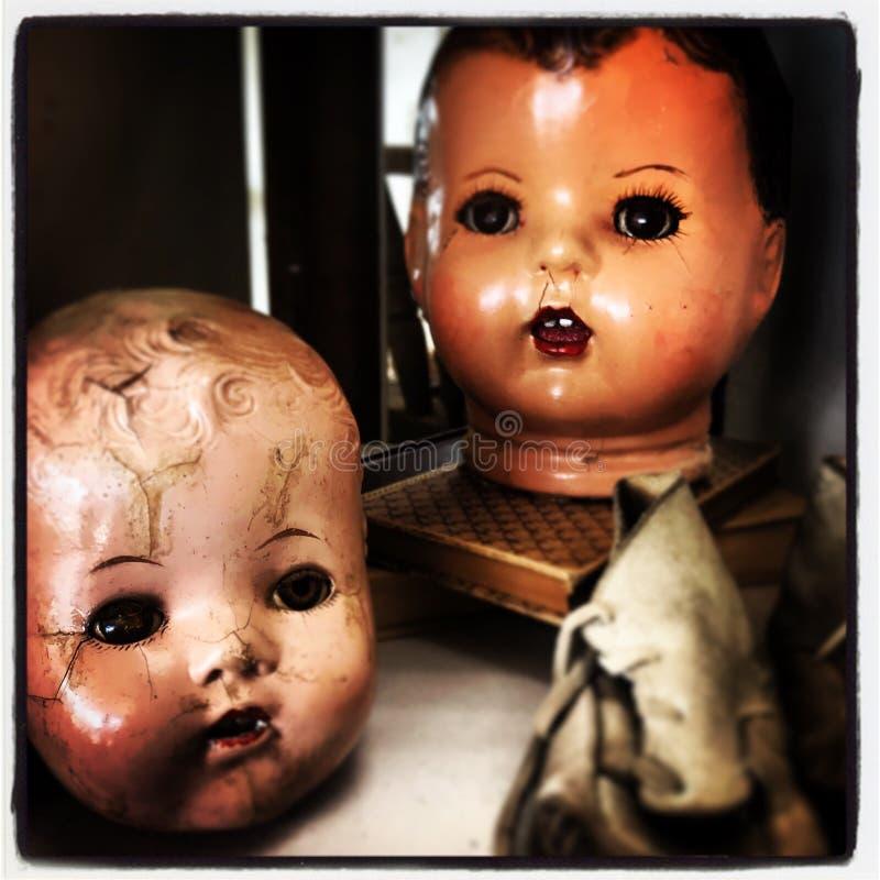 Teste terrificanti della bambola fotografie stock libere da diritti