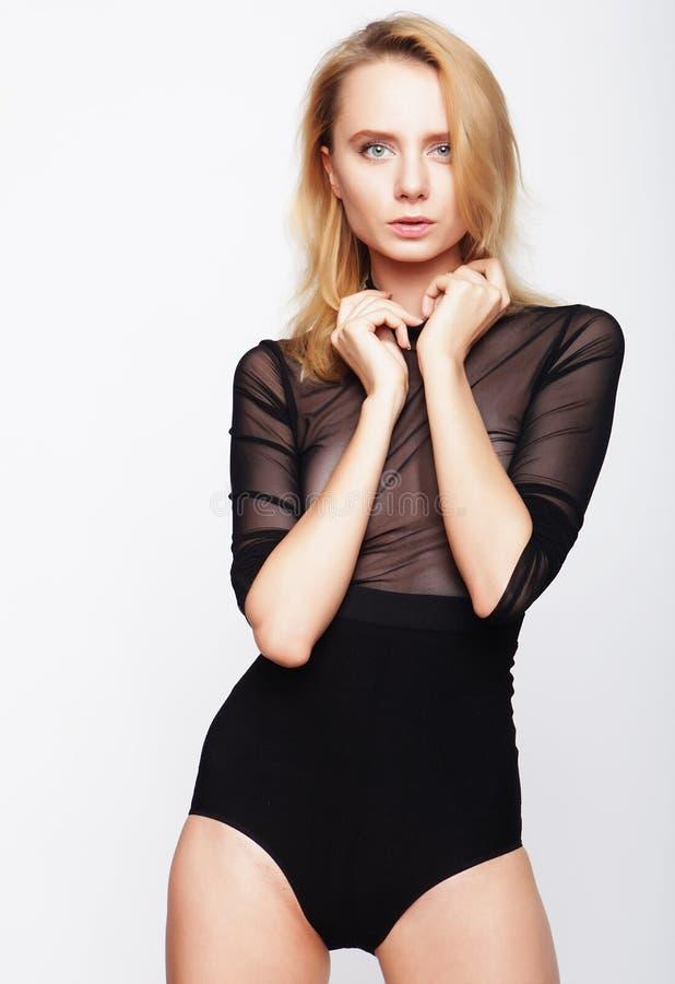 Testes modelo da menina bonita nova sobre o fundo branco fotografia de stock
