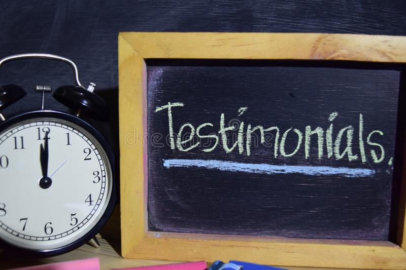 Testimonials on phrase colorful handwritten on blackboard. royalty free stock photo