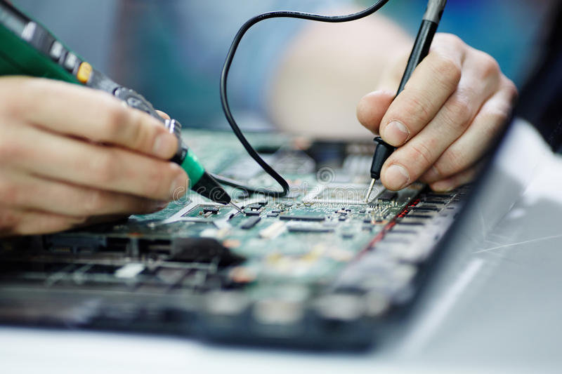 Testing Circuit Board with Multimeter stock photo