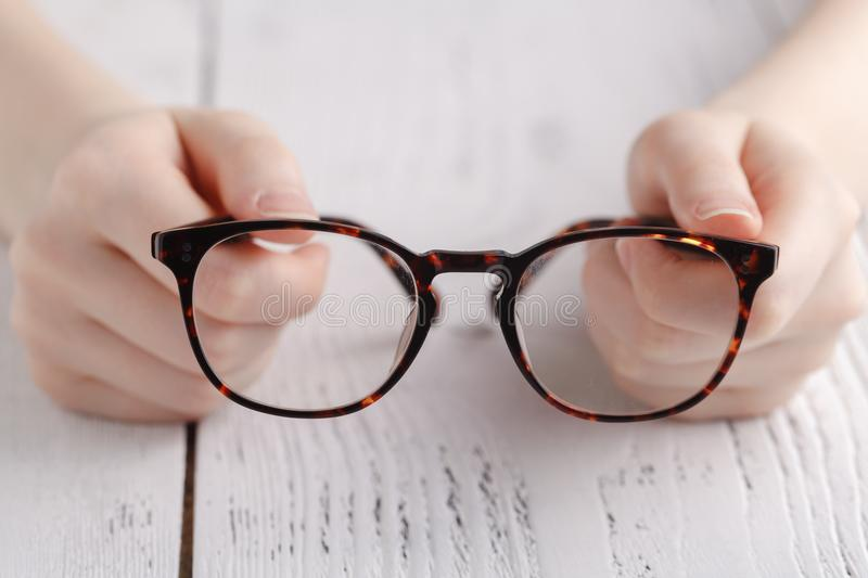 Testing new glasses by female royalty free stock images