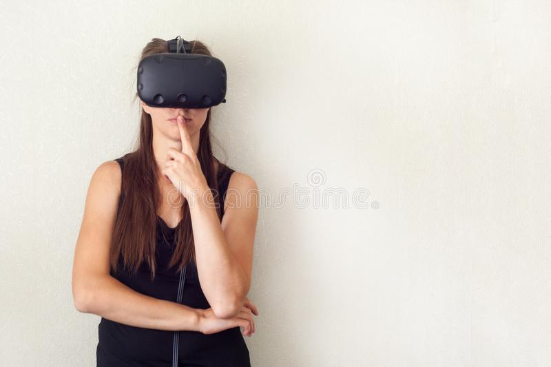 Testing new technologies. Attractive young woman in VR headset gesturing. royalty free stock photo