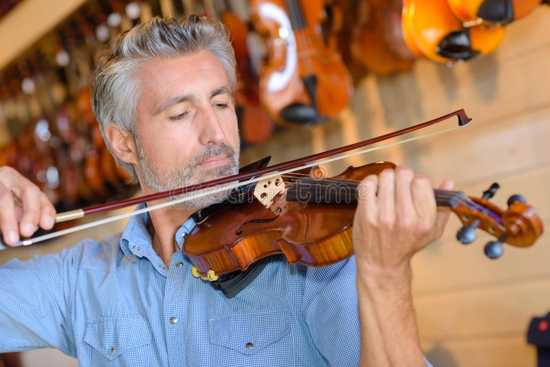 Testing string violin. Testing the string of the violin stock photography