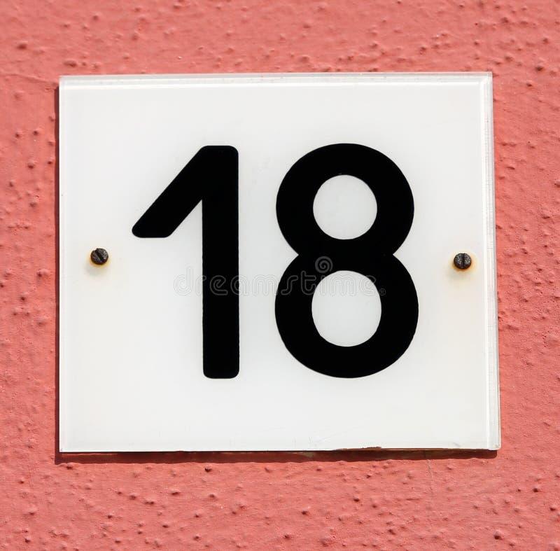 Testo con il numero 18 fotografia stock