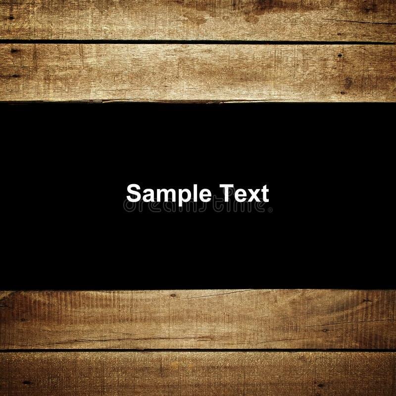 Testo del campione sulla priorità bassa di legno della plancia fotografie stock