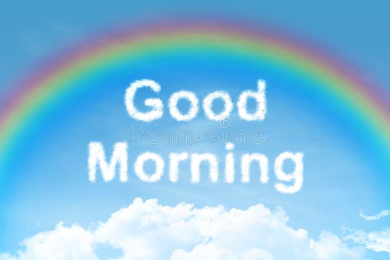 Testo della nuvola di buongiorno con l'arcobaleno fotografia stock