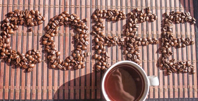 Testo di Coffe e una tazza di caffè immagini stock libere da diritti
