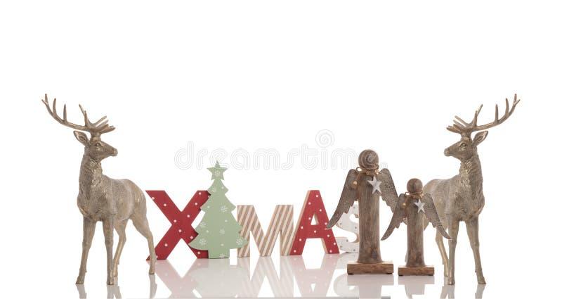 Testo di legno di natale, 2 renne e due angeli fotografie stock libere da diritti