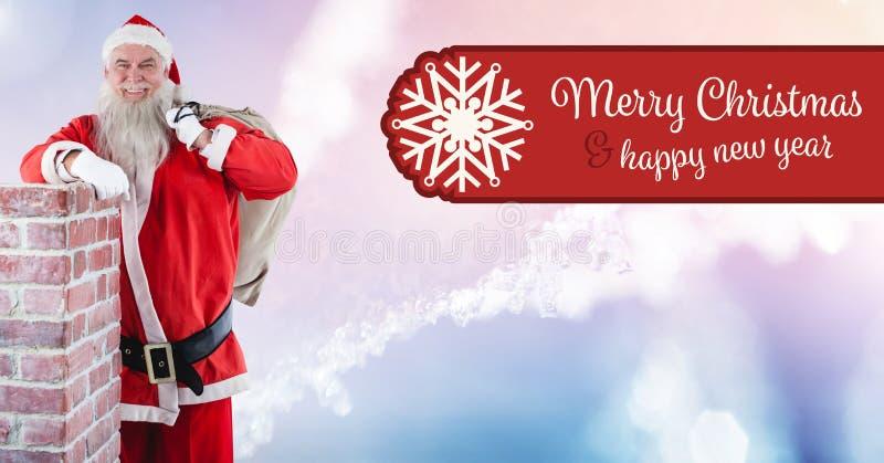 Testo e Santa del buon anno di Buon Natale con il sacco dal camino fotografia stock