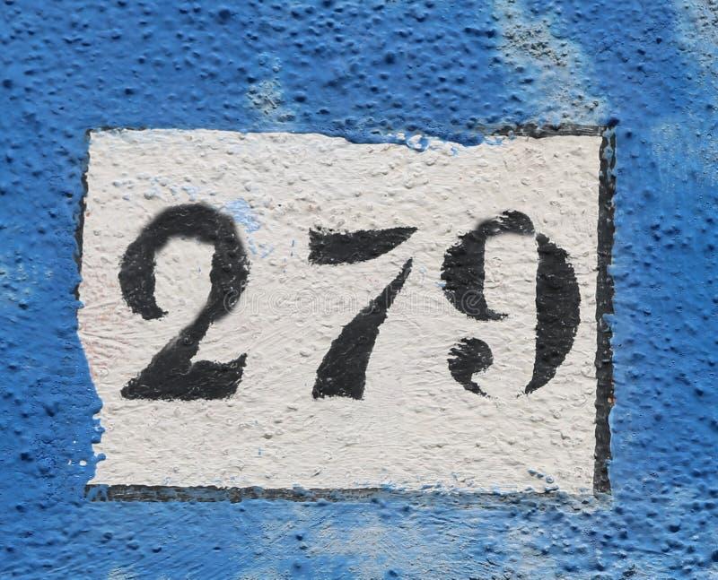 Testo nero con il numero 279 sulla parete fotografia stock libera da diritti