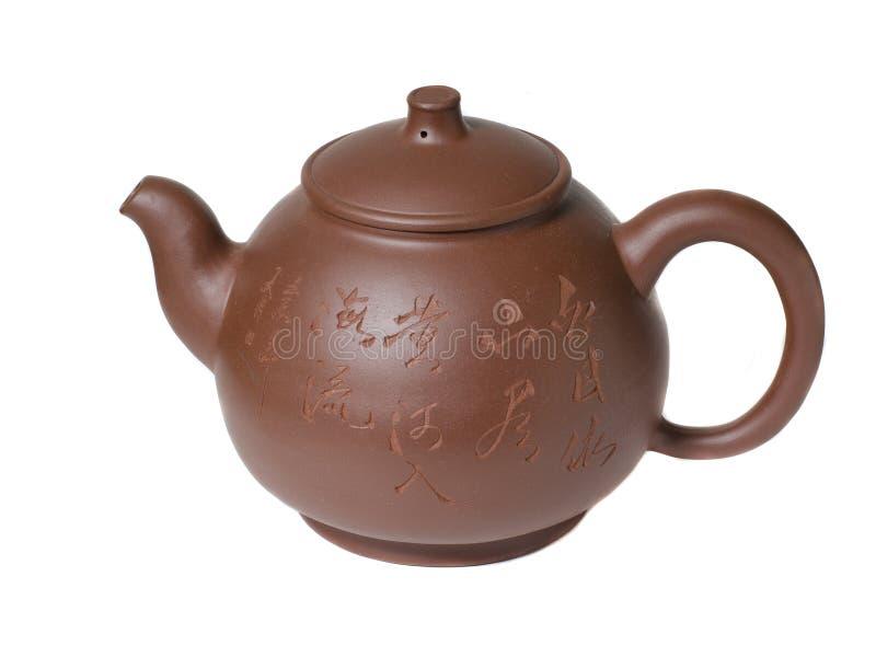 Tetera de la arcilla para el té en estilo chino fotos de archivo