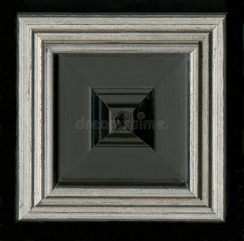 Tetrahedral fyrkantig dekorativ rosett av träinrama remsor fotografering för bildbyråer