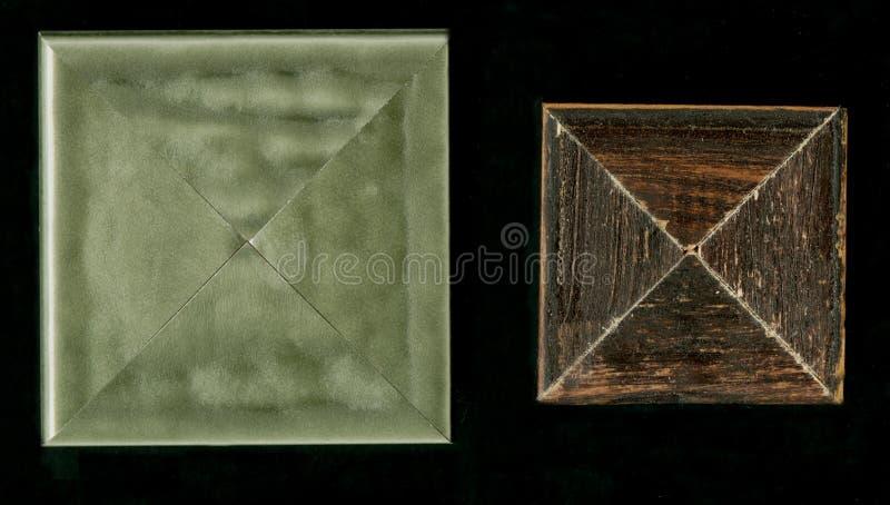 Tetrahedral fyrkantig dekorativ rosett av träinrama remsor royaltyfri fotografi