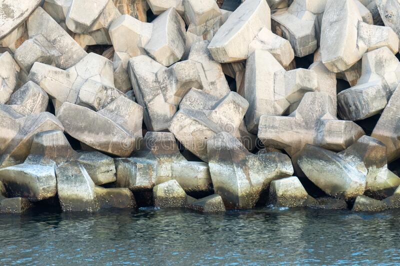 Tetrapods breakwater, a structure in coastal engineering used to prevent erosion caused by sea wave and strong wind and protect royalty free stock images