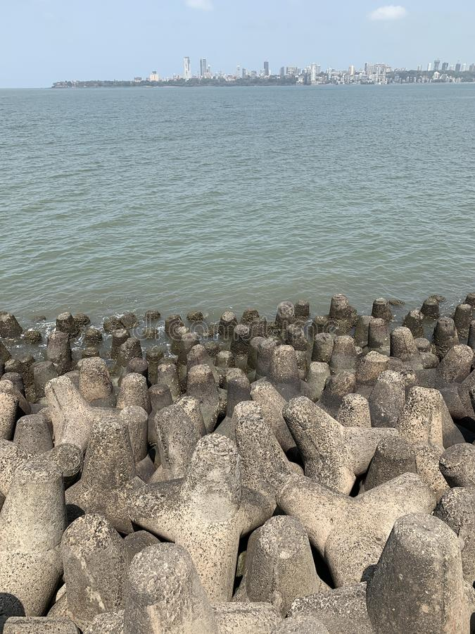 Tetrapods, coastal erosion prevention, mumbai coastline. Tetrapods are a type of structure in coastal engineering used to prevent erosion caused by weather and royalty free stock images
