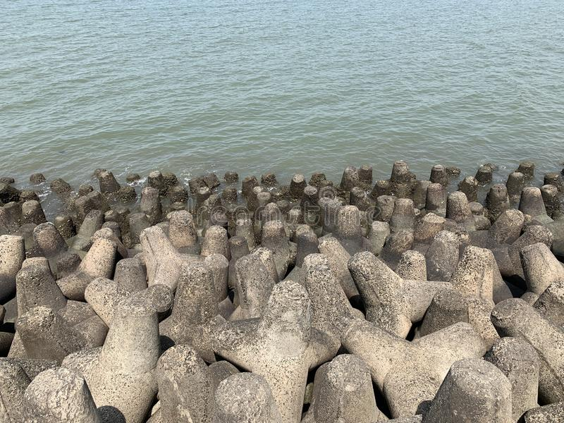Tetrapods, coastal erosion prevention, Mumbai Skyline. Tetrapods are a type of structure in coastal engineering used to prevent erosion caused by weather and stock photos