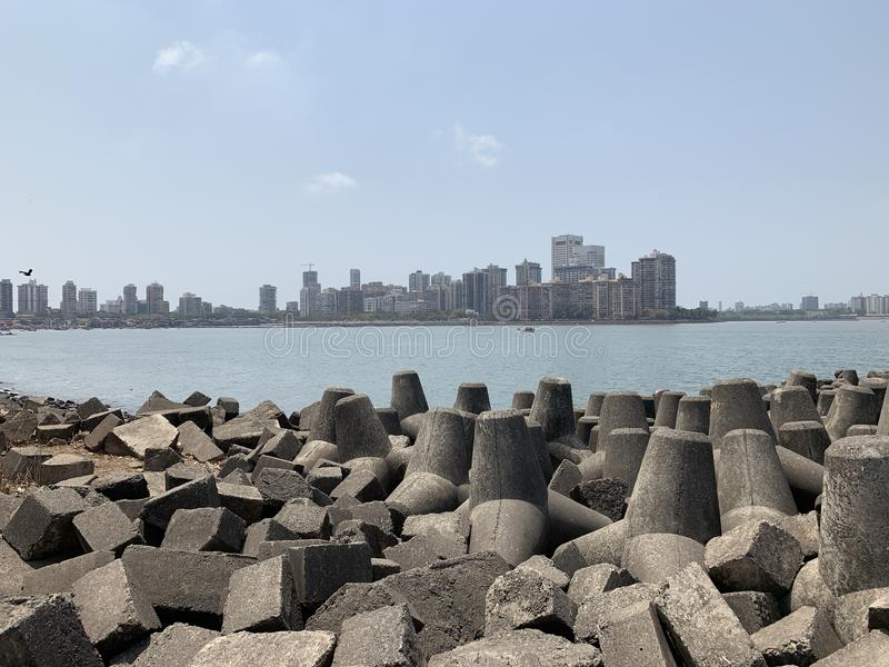 Tetrapods, coastal erosion prevention, Colaba Mumbai. Tetrapods are a type of structure in coastal engineering used to prevent erosion caused by weather and stock photography