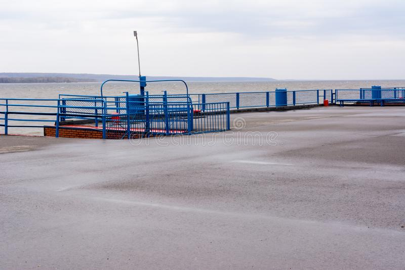 Tetyushi, Tatarstan / Russia - May 2, 2019: Empty passenger river port on the Volga River on a rainy day. Problems of the inland stock photography