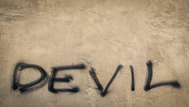 Teufel auf der Wand stockfotografie