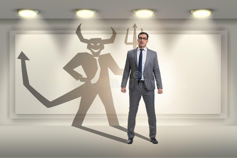 Teufel, der im Gesch?ftsmann - alter ego-Konzept sich versteckt stockbilder