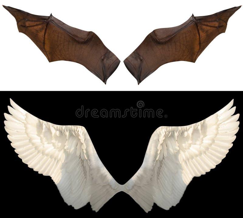 Teufel- und Engelsflügel stockfoto