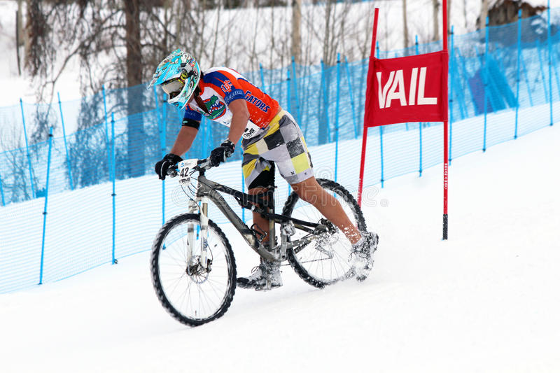 Teva Dual Slalom Bike. Preeminent mountain bikers combine precision with pure guts in this all-out speed descent on Vail Mountain's Golden Peak. This head-to royalty free stock image