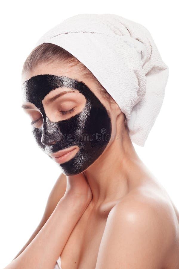 Tevreden jong meisje met zwart masker royalty-vrije stock fotografie