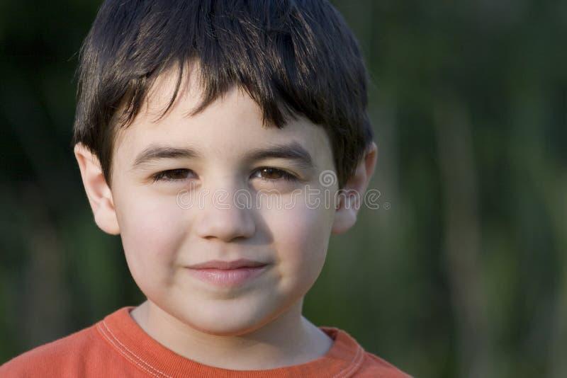 Tevreden jongen stock foto