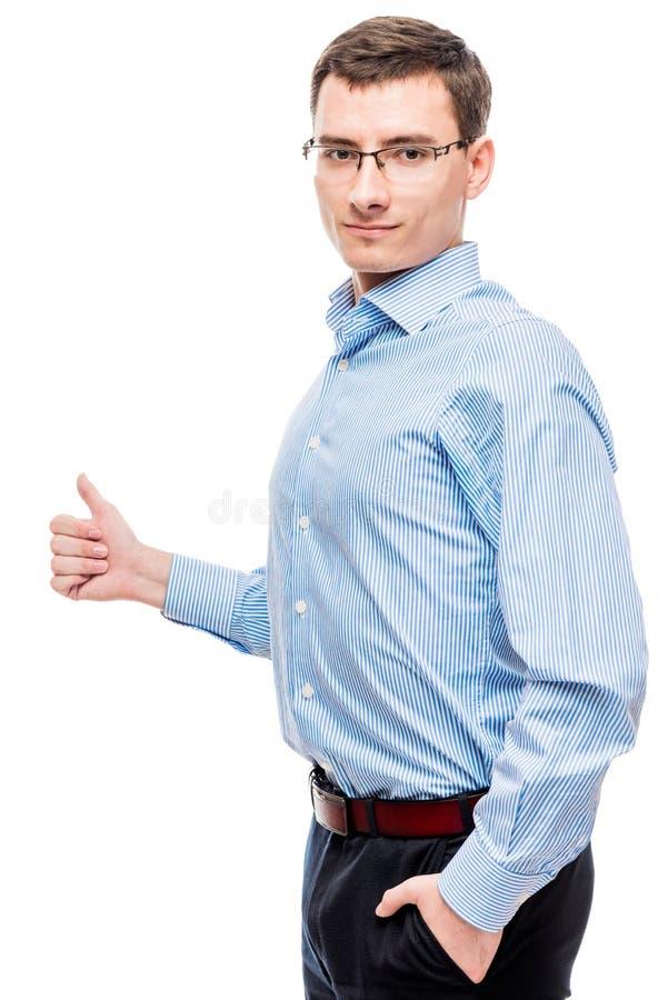Tevreden succesvolle ondernemer die duimen op wit tonen stock foto's