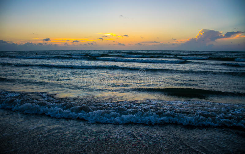 Texas Beach Coast Waves crashing Sunrise before sun rise. Surfs Up at Padre Island Texas Beach Wave Break. Summer time at the beach is a relaxing vacation for royalty free stock image