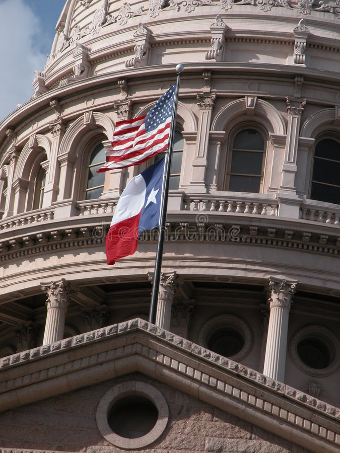 Texas Capitol with flags royalty free stock photo