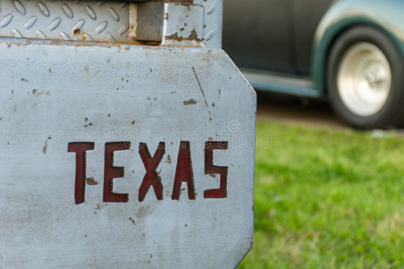 Texas Cut out from Bumper of Old School Hot Rod. The Word Texas cut out in Metal Landmark State , second largest state in the nation metal rugged Old school royalty free stock image