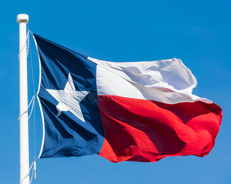 Texas Flag. Blowing in wind on blue sky background stock photography